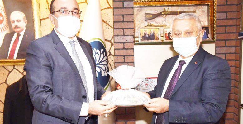 Başkan Zeybek'ten  ilçe ziyaretleri